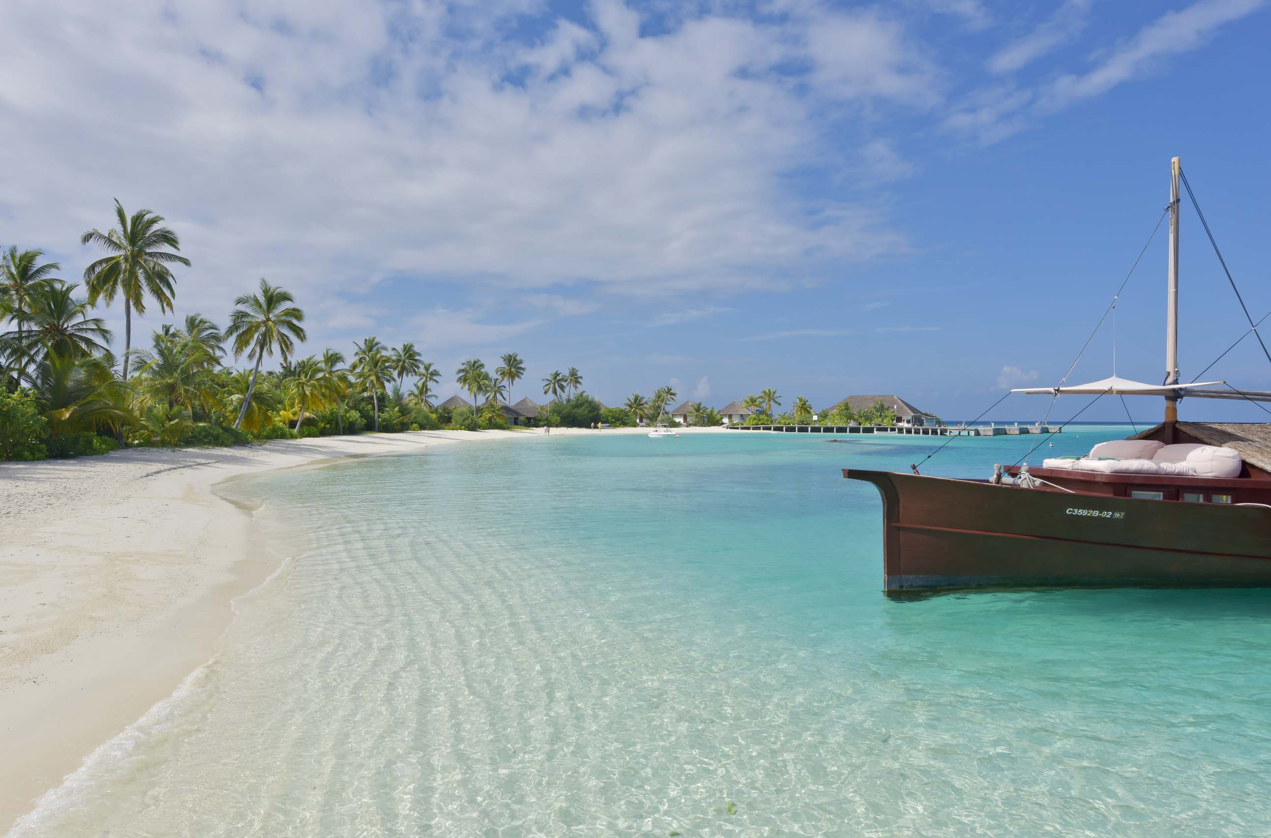 The crystal clear beach in Safari Island, Resort & Spa